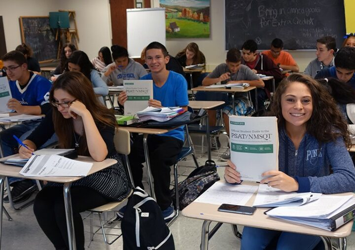 Students pass the PSAT exam in US schools